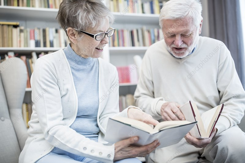 Senior couple reading books
