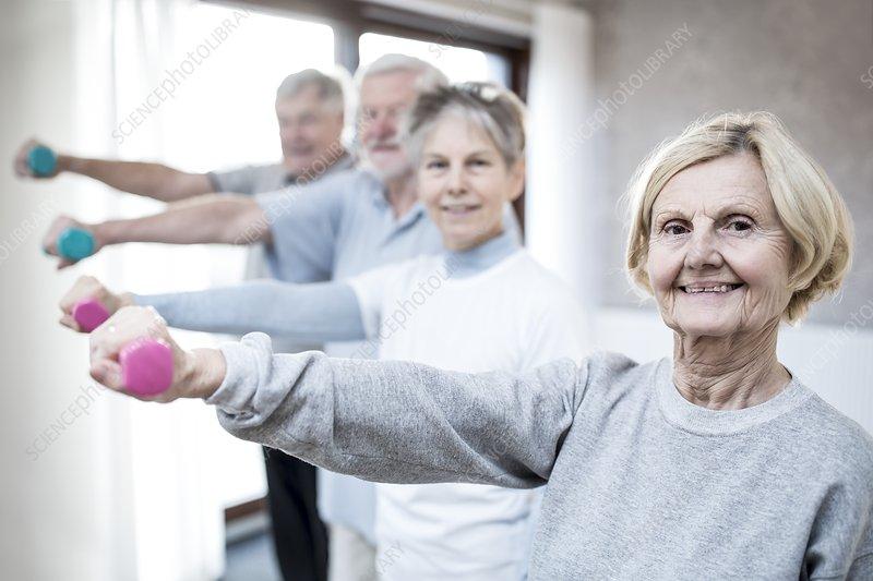 Seniors holding hand weights
