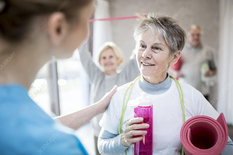 Woman talking to physiotherapist