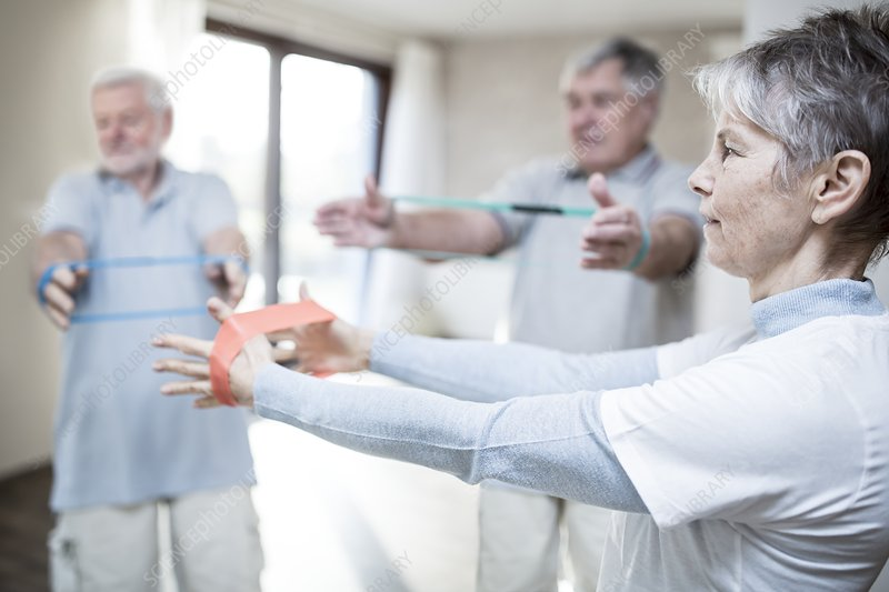Seniors using resistance bands in exercise class
