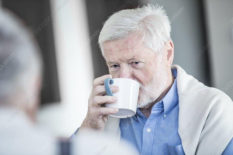 Senior man drinking mug of tea