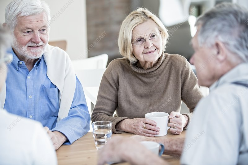 Friends talking in retirement home