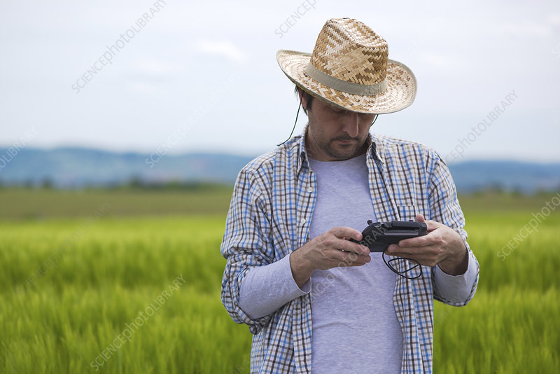 Farmer with drone control