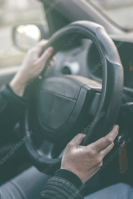 Driver's hands on steering wheel