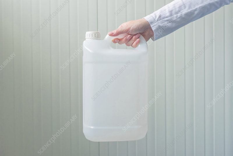 Plastic canister in female hand