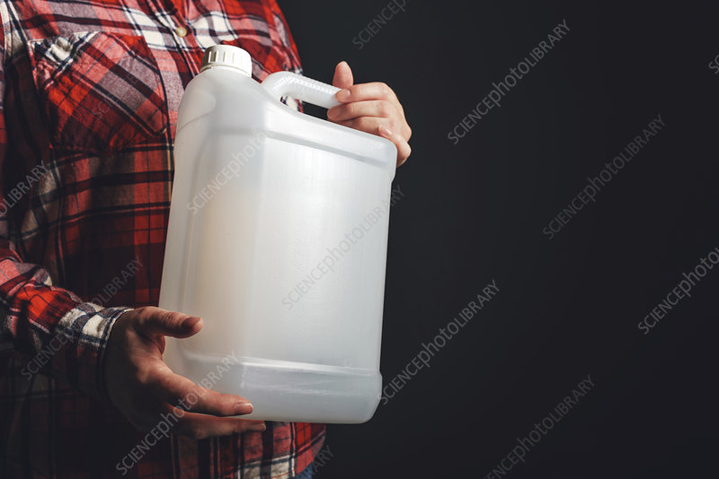 Woman holding plastic canister