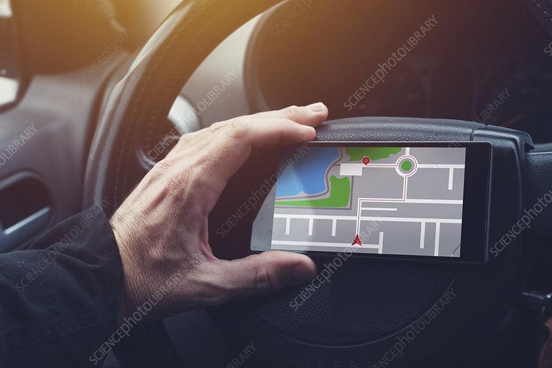 Man using GPS navigation on mobile phone