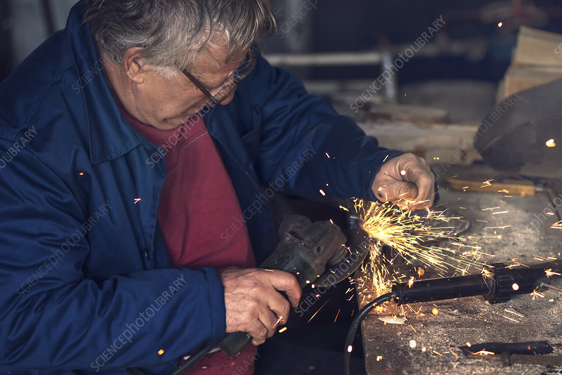 Man using metal grinder