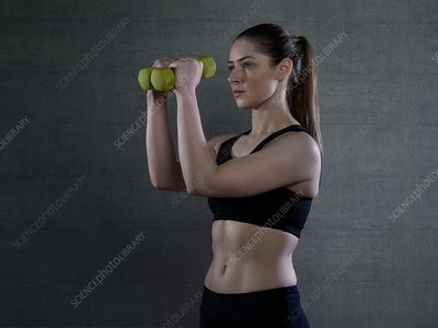 Woman holding hand weights