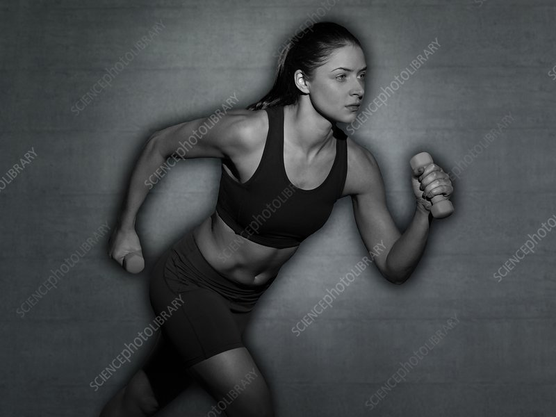 Woman running with hand weights