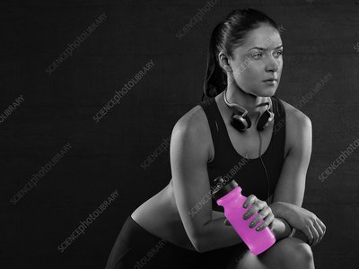 Woman holding pink sports bottle