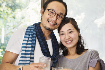 Portrait, smiling woman, man, glasses, standing side by side