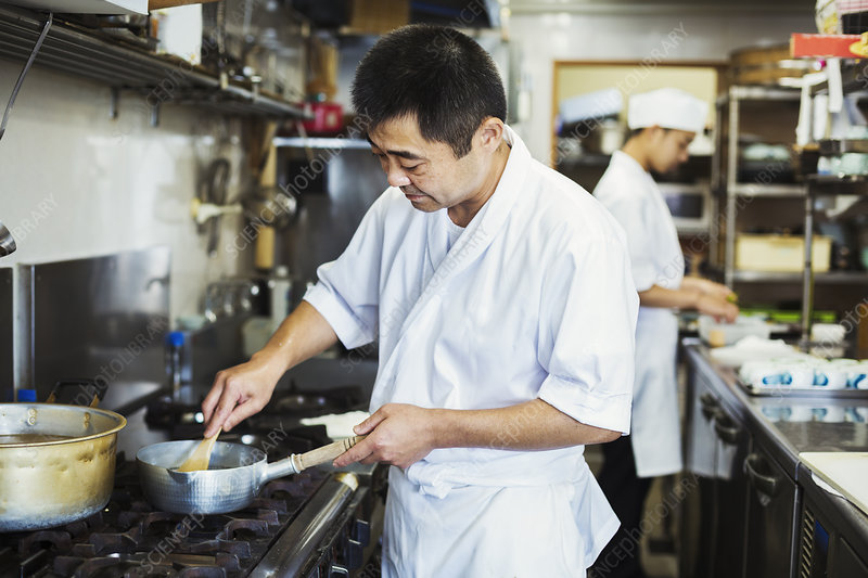 Japanese sushi restaurant chef, cooking on kitchen stove