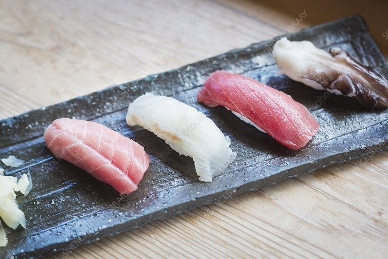 High angle close up, four sushi pieces, rectangular dish