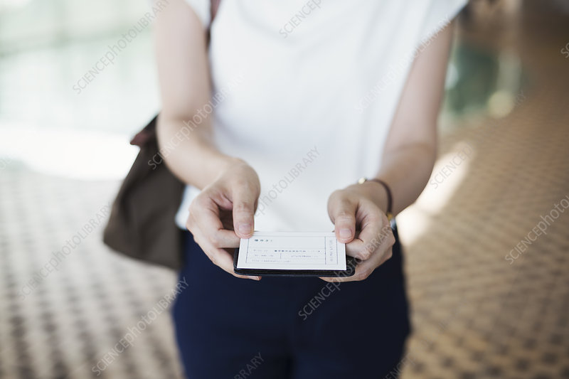 Close up, woman in subway station, ticket, Tokyo commuter