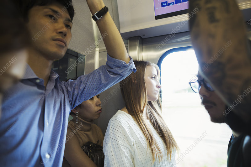 Small group of people on a subway train, Tokyo commuters