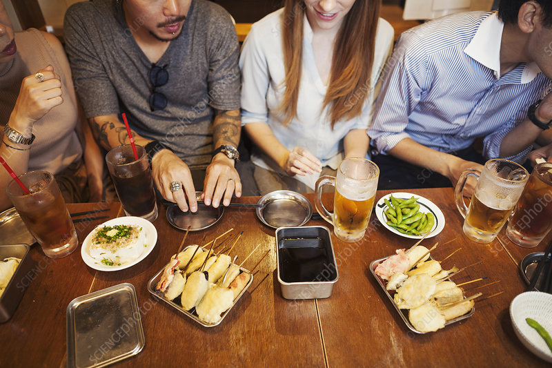 High angle, five people at restaurant table, food and drink
