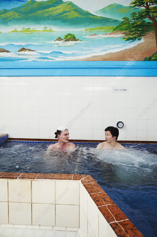 Young Caucasian man, Japanese man in pool, public bath house