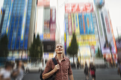 Western man on Tokyo street, blurred background