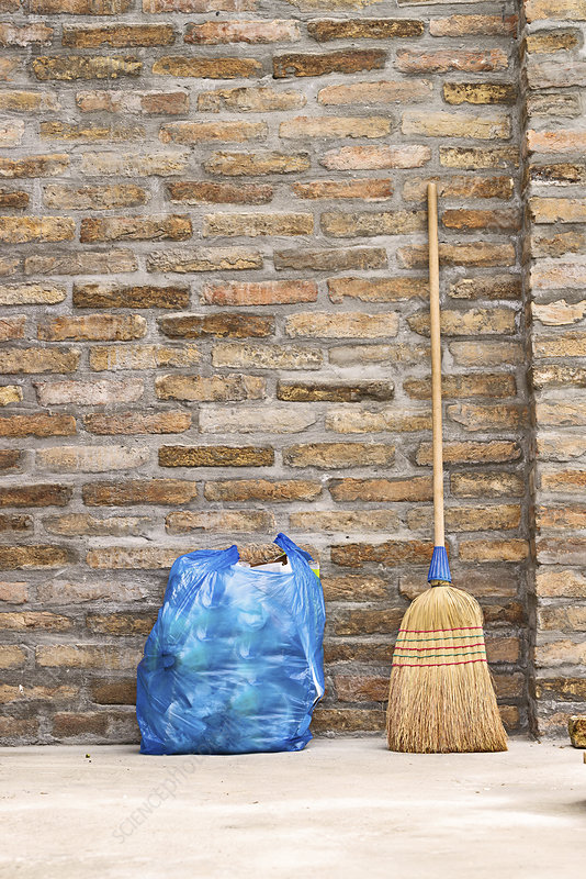 Household broom and bag of rubbish