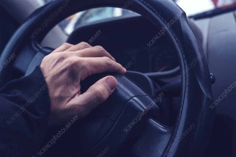 Male hand honking the car horn