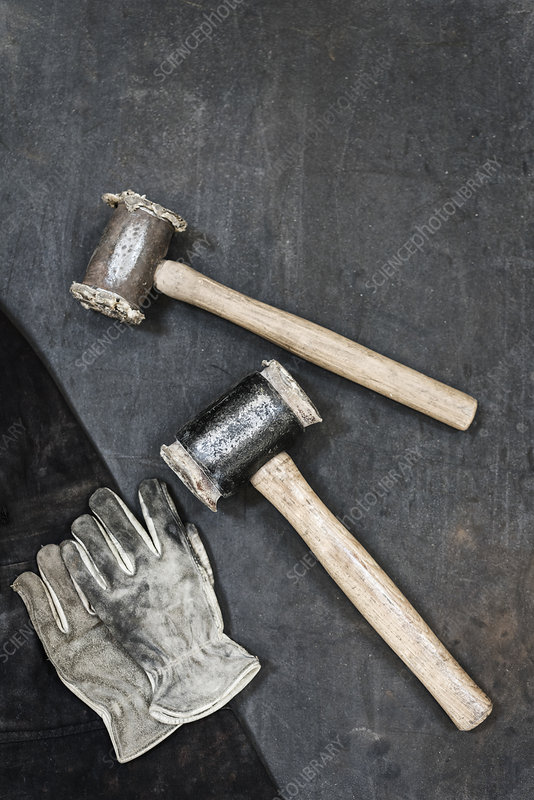 Two hammers and pair of leather safety gloves