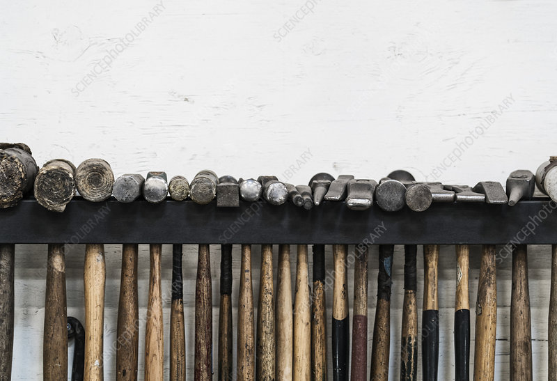Selection of hammers hanging on a wall