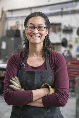 Woman wearing glasses and work apron