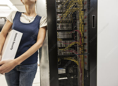 Technician leaning against a server