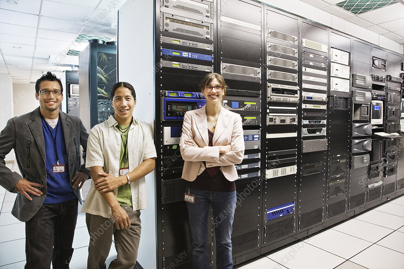 Technicians working in a large server room