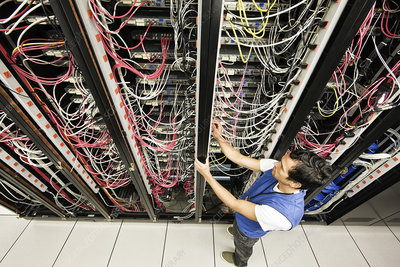 Technician working on a cable bundling system