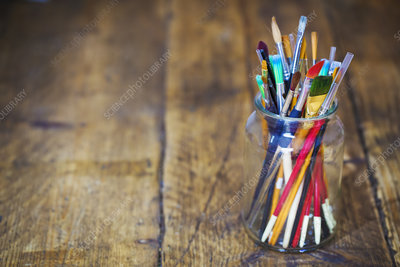 A jar with selection of paintbrushes