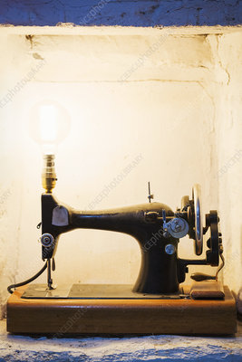 Old fashioned sewing machine converted to lamp