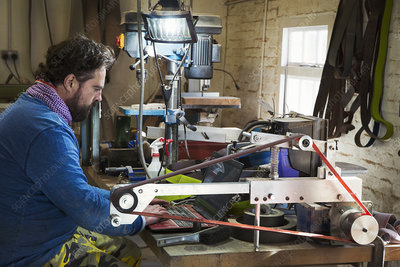 A craftsman in a cluttered workshop