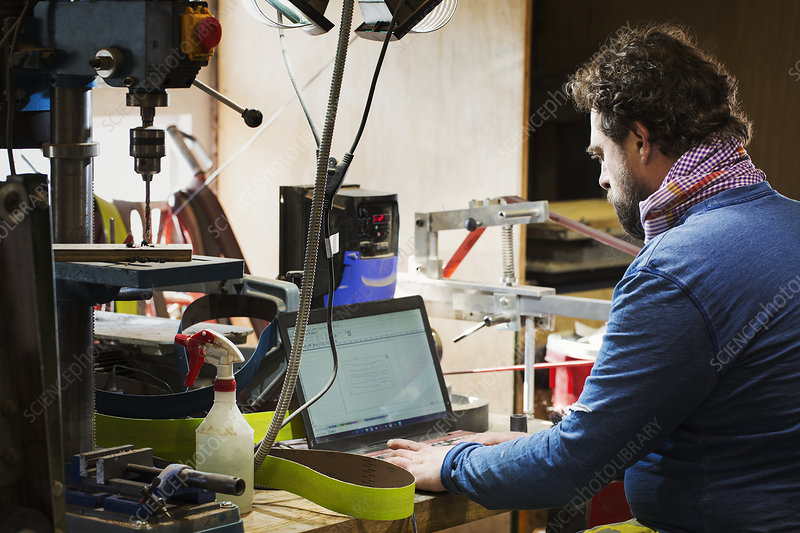 A craftsman using a laptop computer