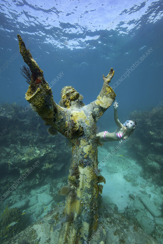 A divers snorkels by Christ of the Abyss Statue