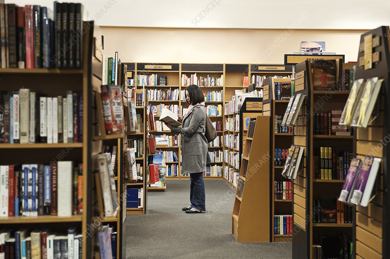 Woman browsing through books