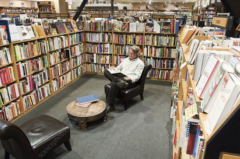 Caucasian male browsing through books