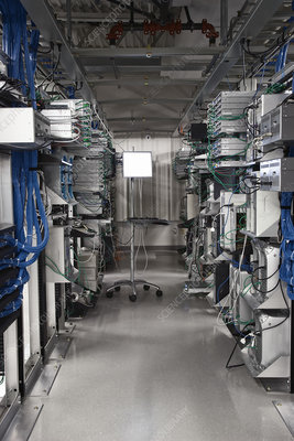server towers in racks in a server farm