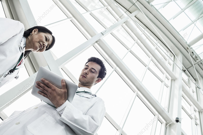 Man and woman doctors meeting