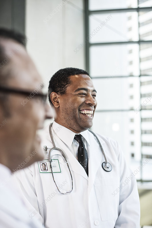Black man doctor in lab coat with a stethoscope