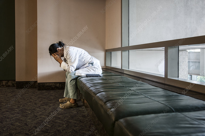 Doctor under stress on a bench