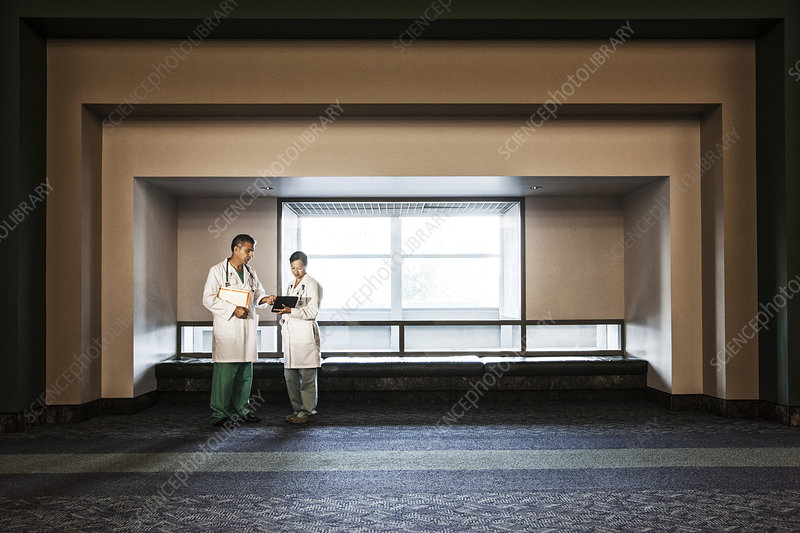 Male and female doctors conferring