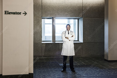 Doctor standing in hospital hallway