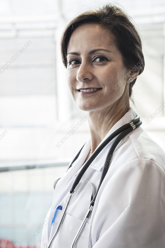 Caucasian female doctor in lab coat