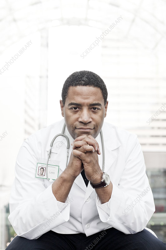 Doctor in lab coat with a stethoscope