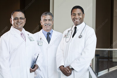 Mixed race group of doctors in lab coats
