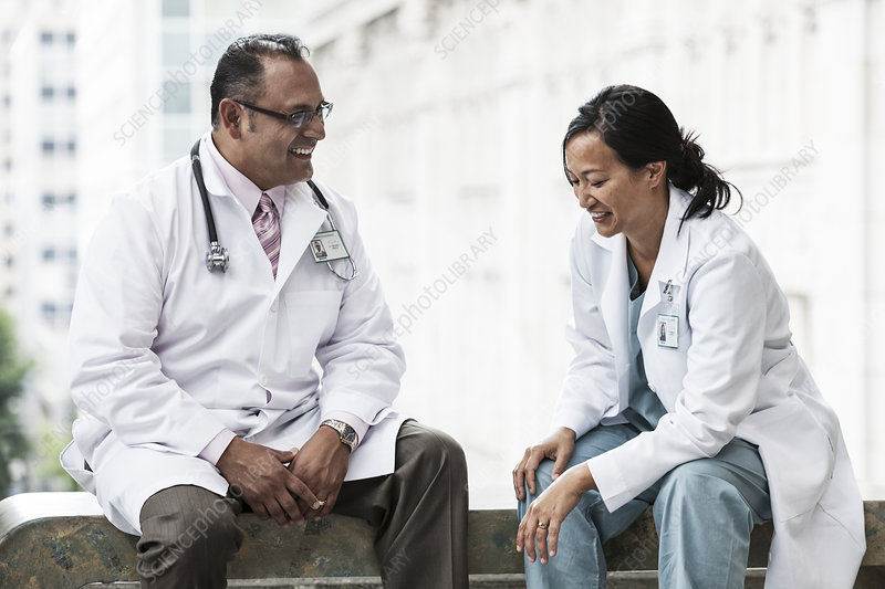 Hispanic man and Asian woman doctors
