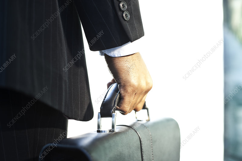 Hand of a black businessman holding a brief case