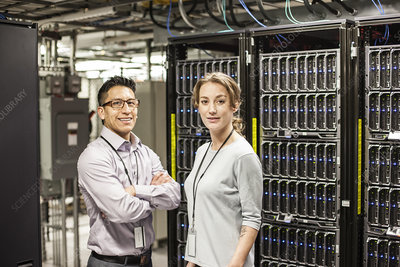 Technicians in a large computer server farm